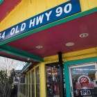 The address on the front of Del Bravo Record Shop still identifies as Old Highway 90.