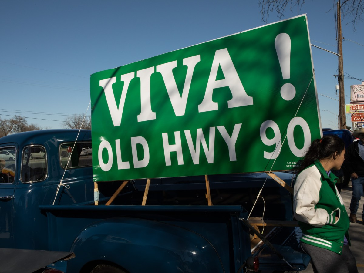 A sign campaigning for a name change sits in a truck on Enrique M. Barrera Parkway, formerly known as Old Highway 90.