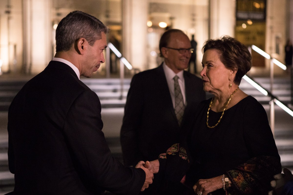 Mayor Ron Nirenberg (left) shakes hands with the new chairwoman of the Symphony Society of San Antonio Kathleen Weir Vale before the second of two Tricentennial concerts.