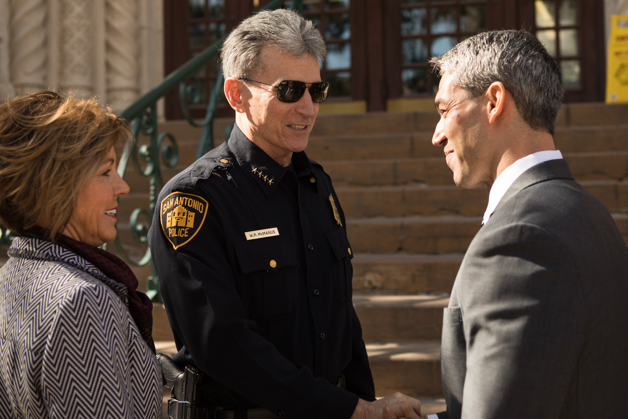 (From left) City Manager Sheryl Sculley, San Antonio Police Chief William McManus, and Mayor Ron Nirenberg greet one another outside of City Hall.