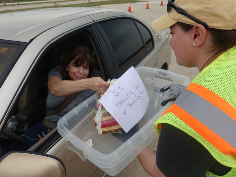 A SAWS employee receives expired medication from a citizen.