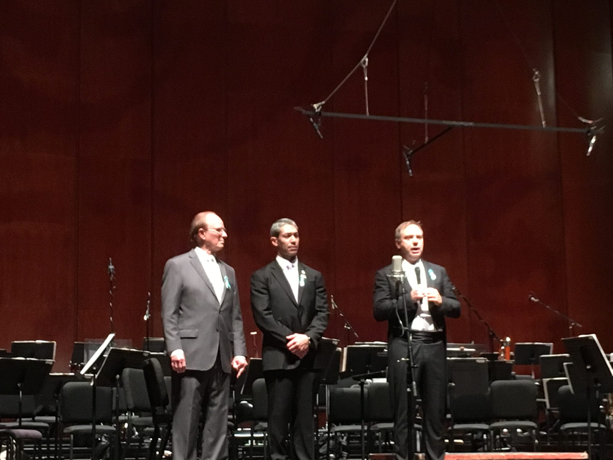 (From left) Bexar County Judge Nelson Wolff, Mayor Ron Nirenberg, and Sebastian Lang-Lessing, the San Antonio Symphony's music director, speak on stage at the second of two Tricentennial concerts.