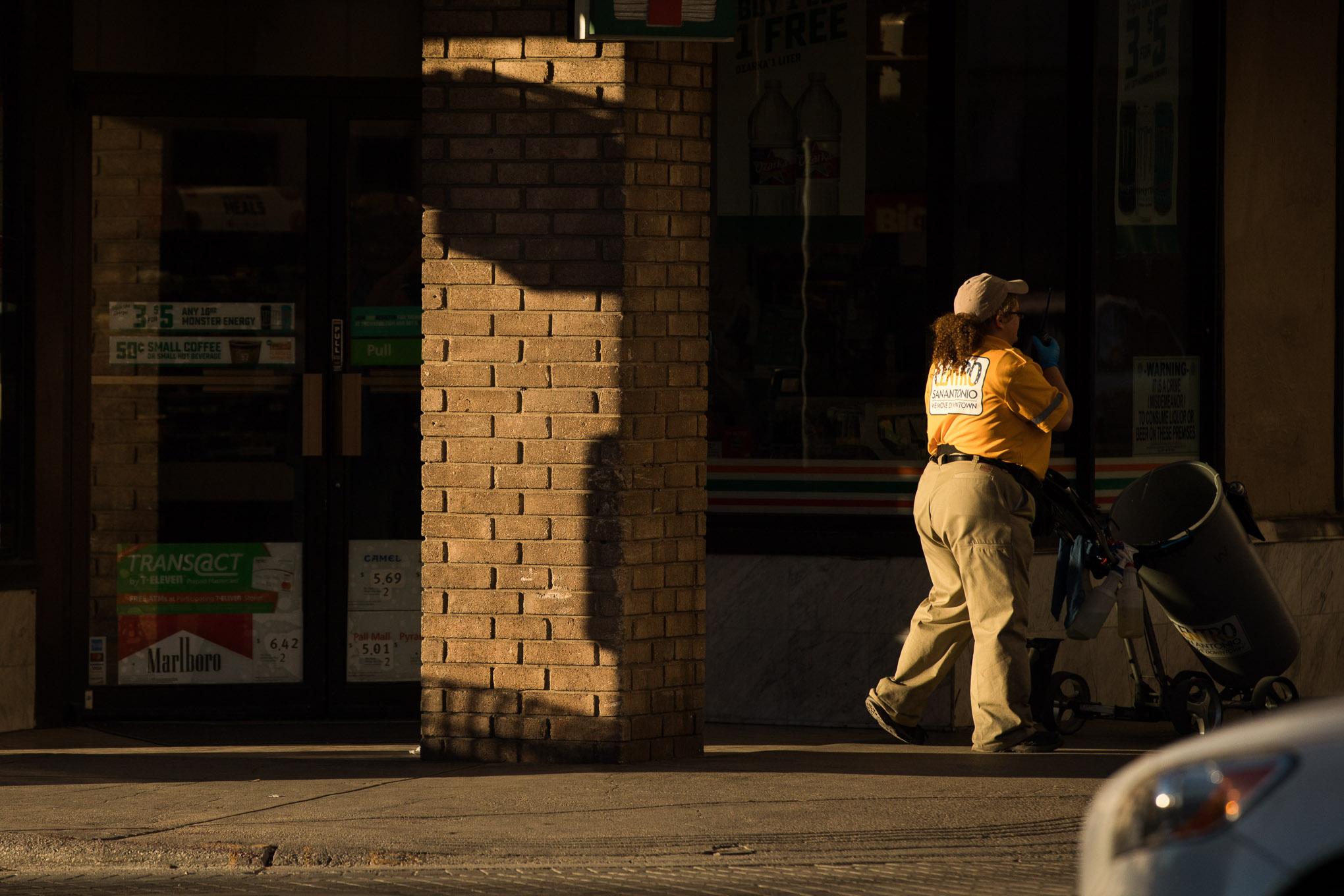 A Centro Ambassador walks along Main Street at the corner of Commerce Street.