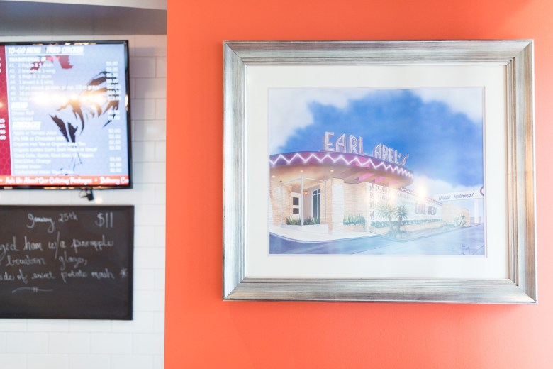 A painting of the original Earl Abel's is framed near the entrance of the latest iteration of the historic diner.