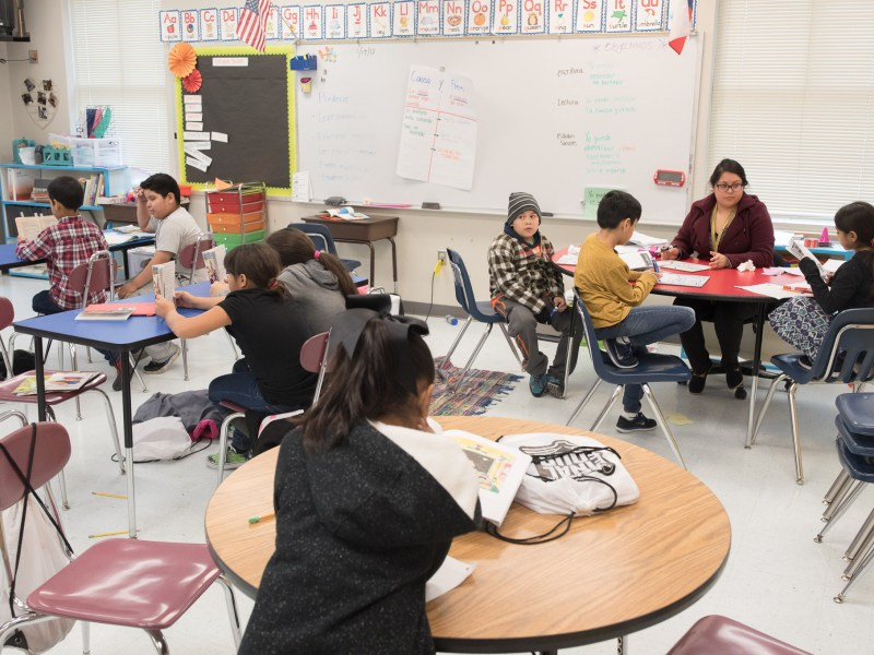 Jacinia Luevanos works with students in 3rd-grade bilingual reading.