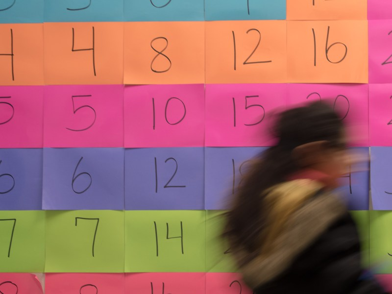 A student at Stonewall Flanders Elementary walks by a large times table in the hallways. Principal Tracie Smith enlisted the help of parents to create the educational wall art.