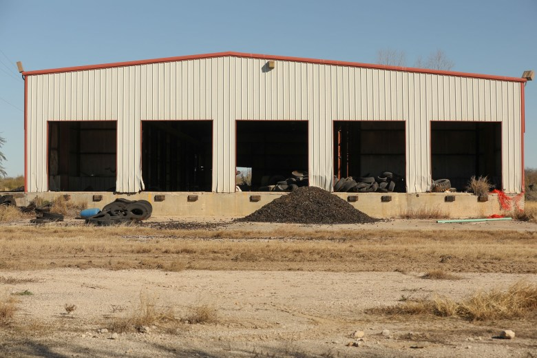 A warehouse on the property is also used as a tire dump.