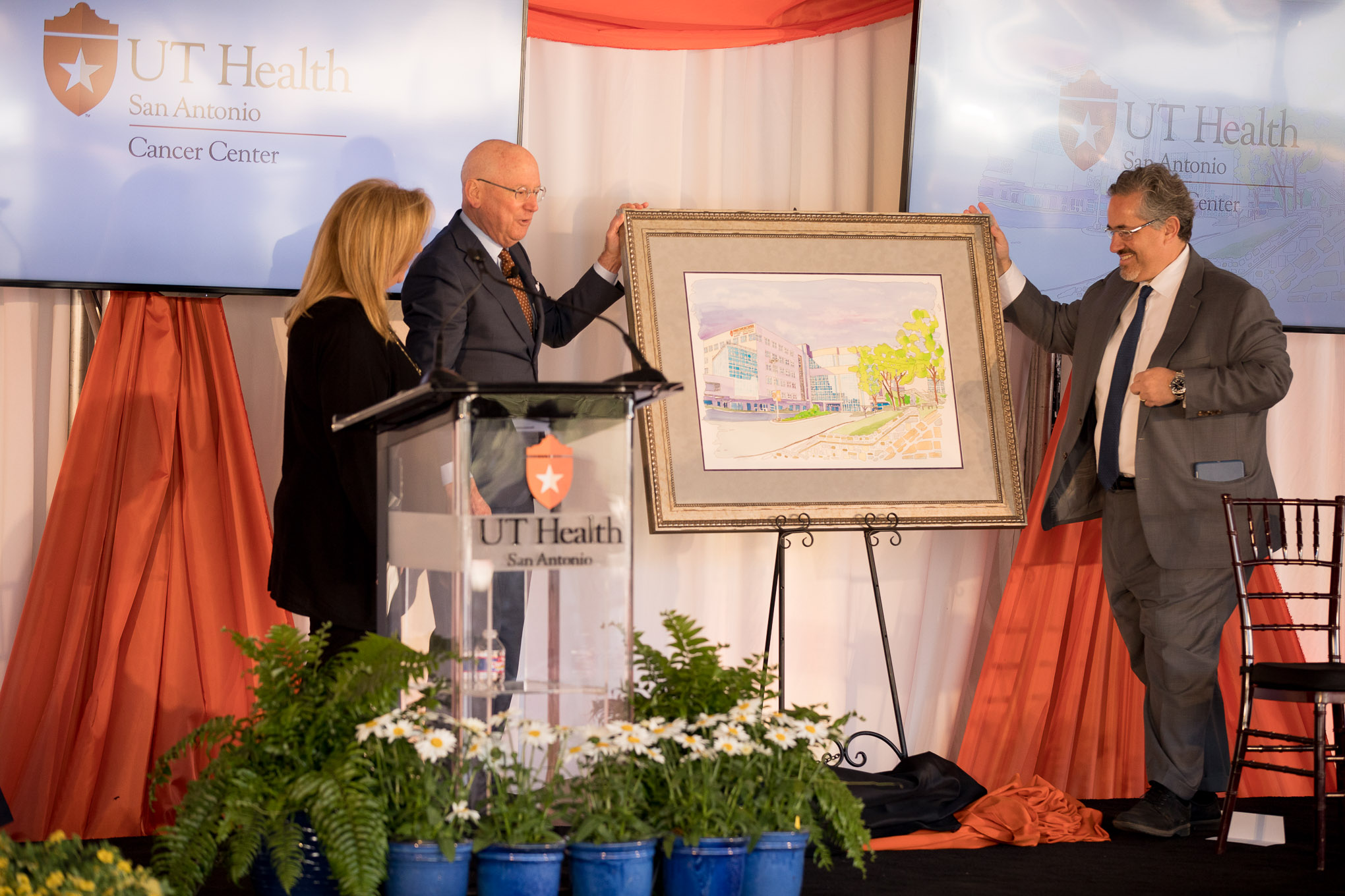A painting of the Cancer Center is displayed as a gift to Kathryn Mays Johnson.