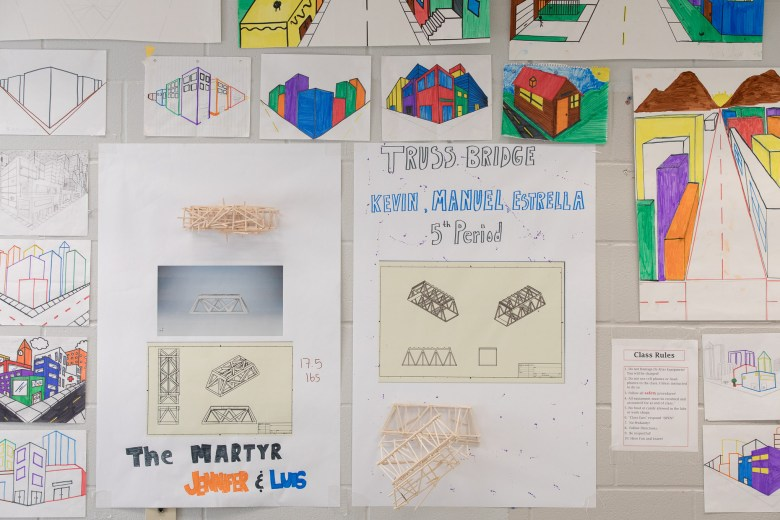 Engineering projects adorn the walls of a Memorial High School classroom including one project titled 'The Martyr' by Jennifer Salazar and Luis Martinez.