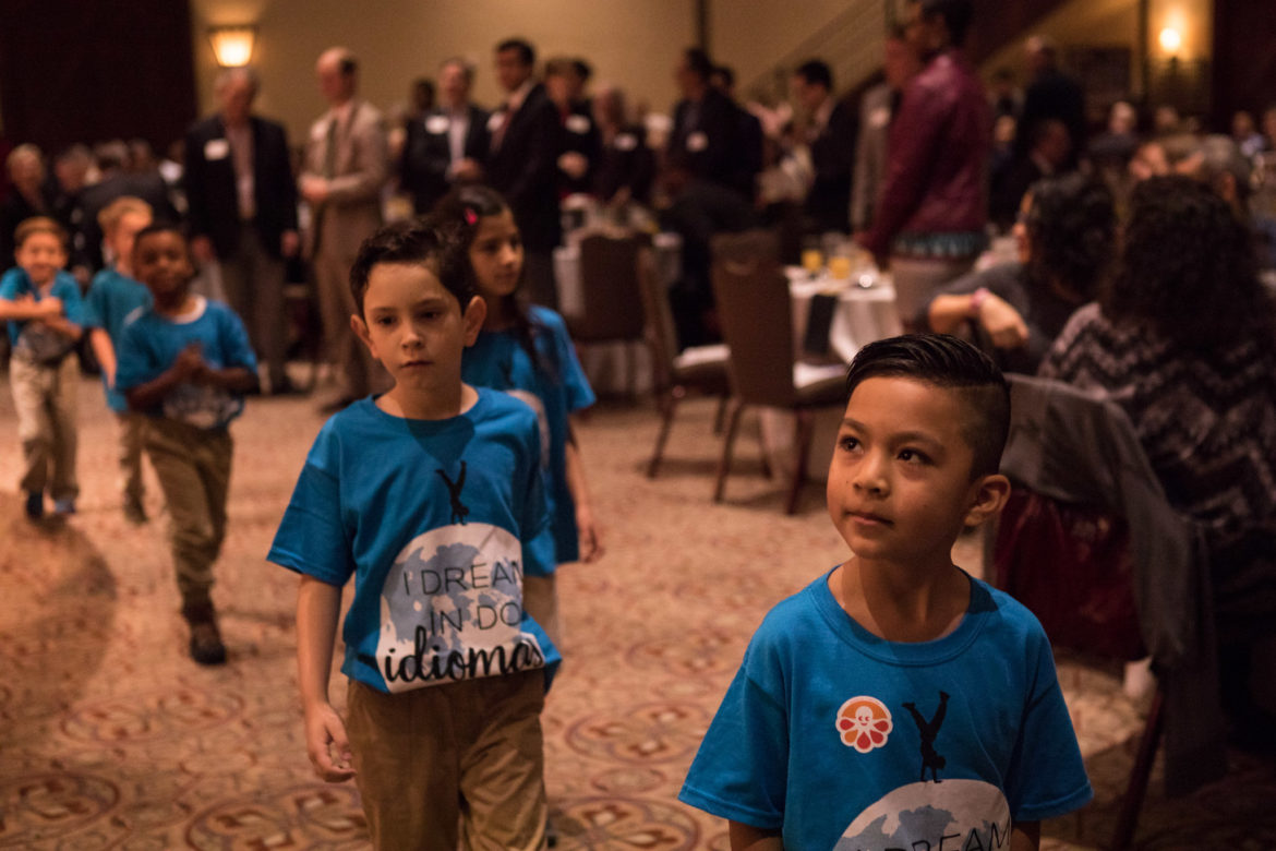 Twain Dual Language Students walk off stage after saying the U.S. Pledge of Allegiance in multiple languages before the SAISD 2018 State of the District.