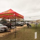 San Antonio Firefighters set up a tent with petition forms next to the Brook Hollow Library voting site.