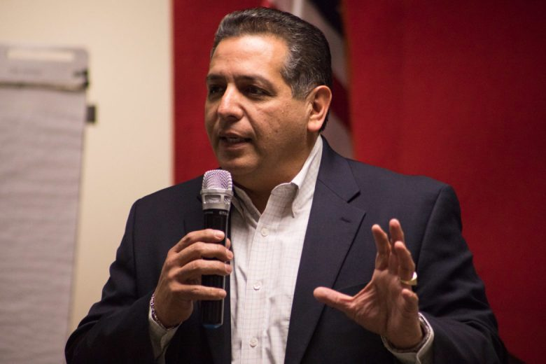 John Lujan speaks during a campaign event at the Bexar County Republican Headquarters.