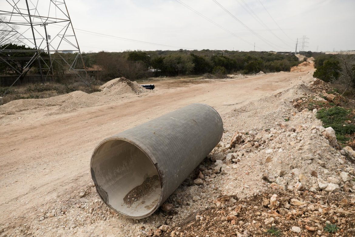 A large concrete pipe lays on the ground near the Vista Ridge pipeline project site in Stone Oak.