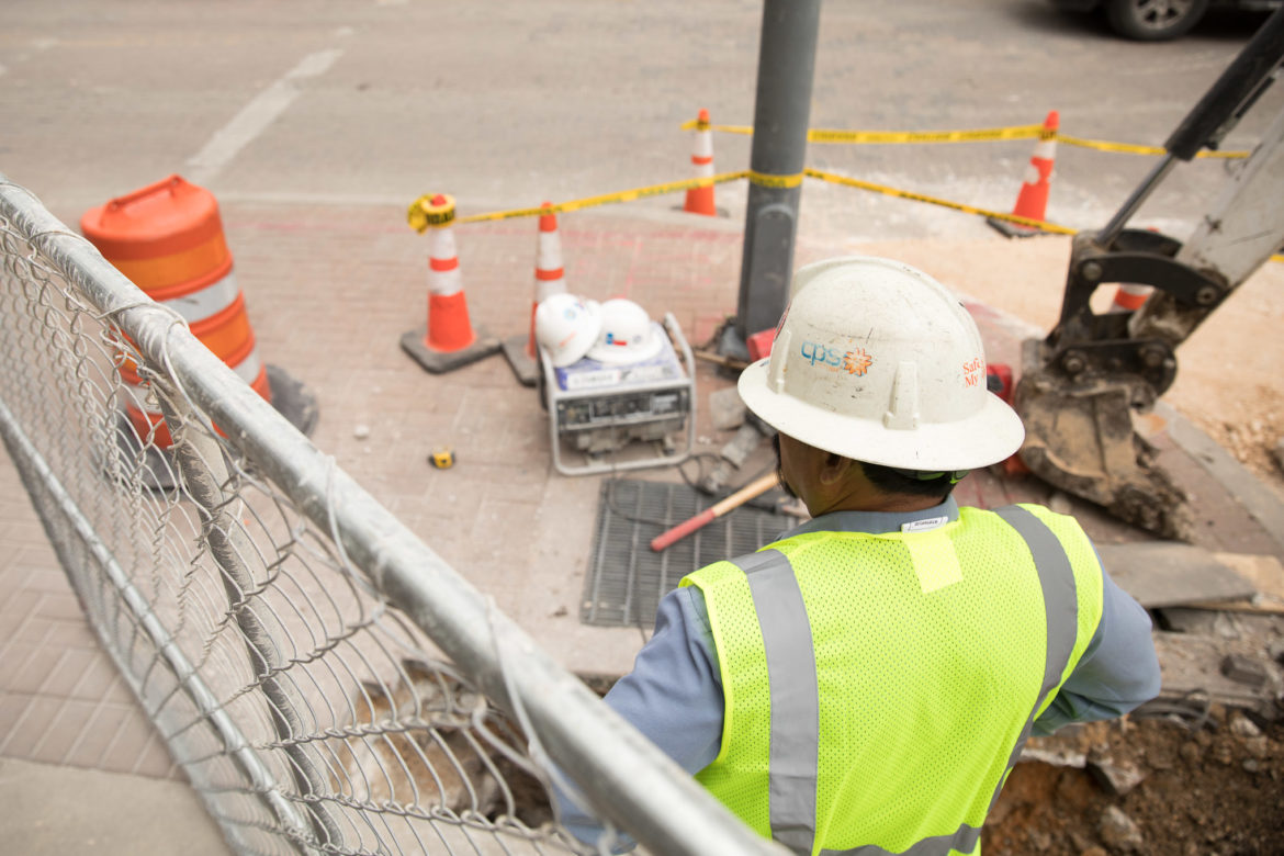 A CPS Energy worker oversees a project at the corner of East Houston and Soledad.
