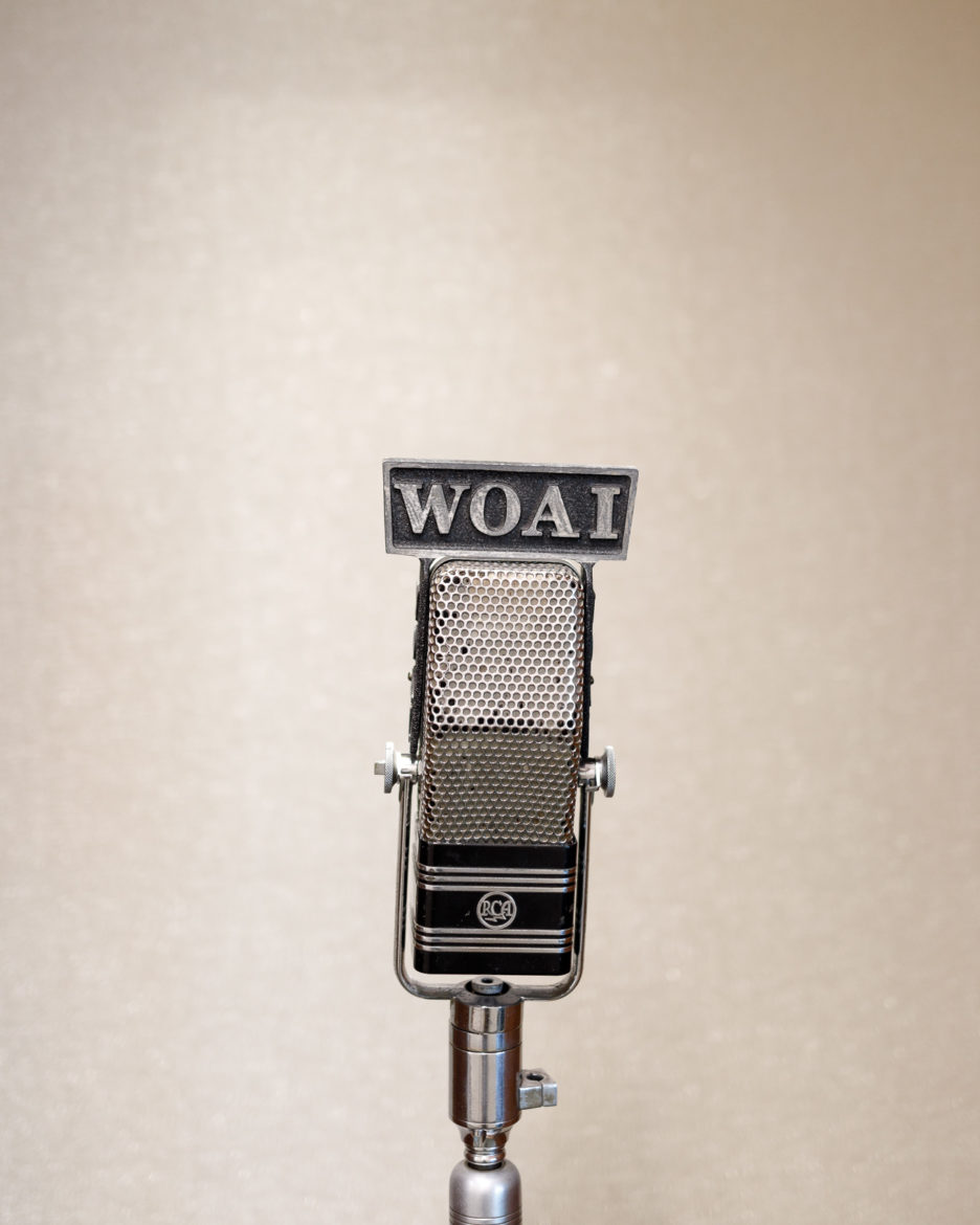 A WOAI microphone holds a prominent spot in the Mays Family Foundation hallway.
