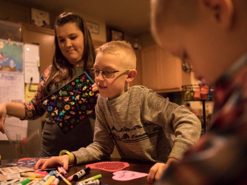 Jacob, an 8-year-old North East Independent School District student who has been diagnosed with dyslexia, makes valentines with his family.