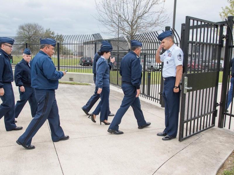 USAF MSgt Robert Ortiz salutes as Partner Nation Generals enter the San Antonio / Bexar County Emergency Operations Center compound during IAAFA's Western Hemisphere Exchange Symposium.