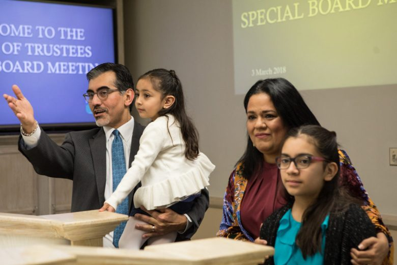 (From left) Mike Flores, who will take over as Alamo Colleges chancellor on Oct. 1, introduces his youngest daughter Mia Ximena, his wife Martha Martinez-Flores, and his older daughter Mara Zoe.