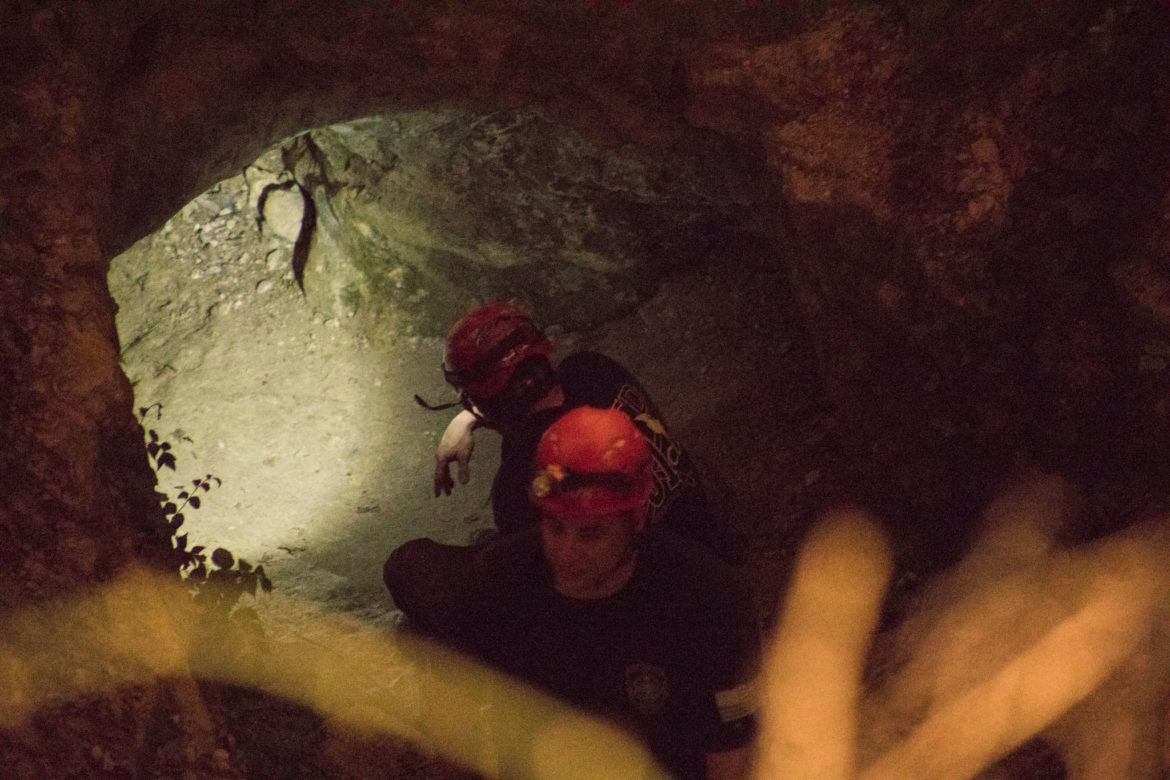 San Antonio firefighters work to extract a student trapped in Robber Baron Cave.