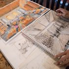 Artist Claudio Aguillon shows the sketches, drawings, and paintings he created for Chef Johnny Hernandez.