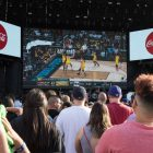 A large crowd gathers at the March Madness Music Festival to watch the Chicago Loyola University and Michigan University game during the 2018 NCAA Final Four.