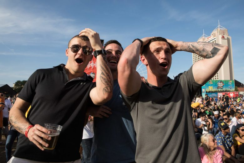 (From left) Nicholas Cobb, Garret Rigdon, and Ken Ellis react to the Chicago Loyola University and Michigan University game during the 2018 NCAA Final Four.