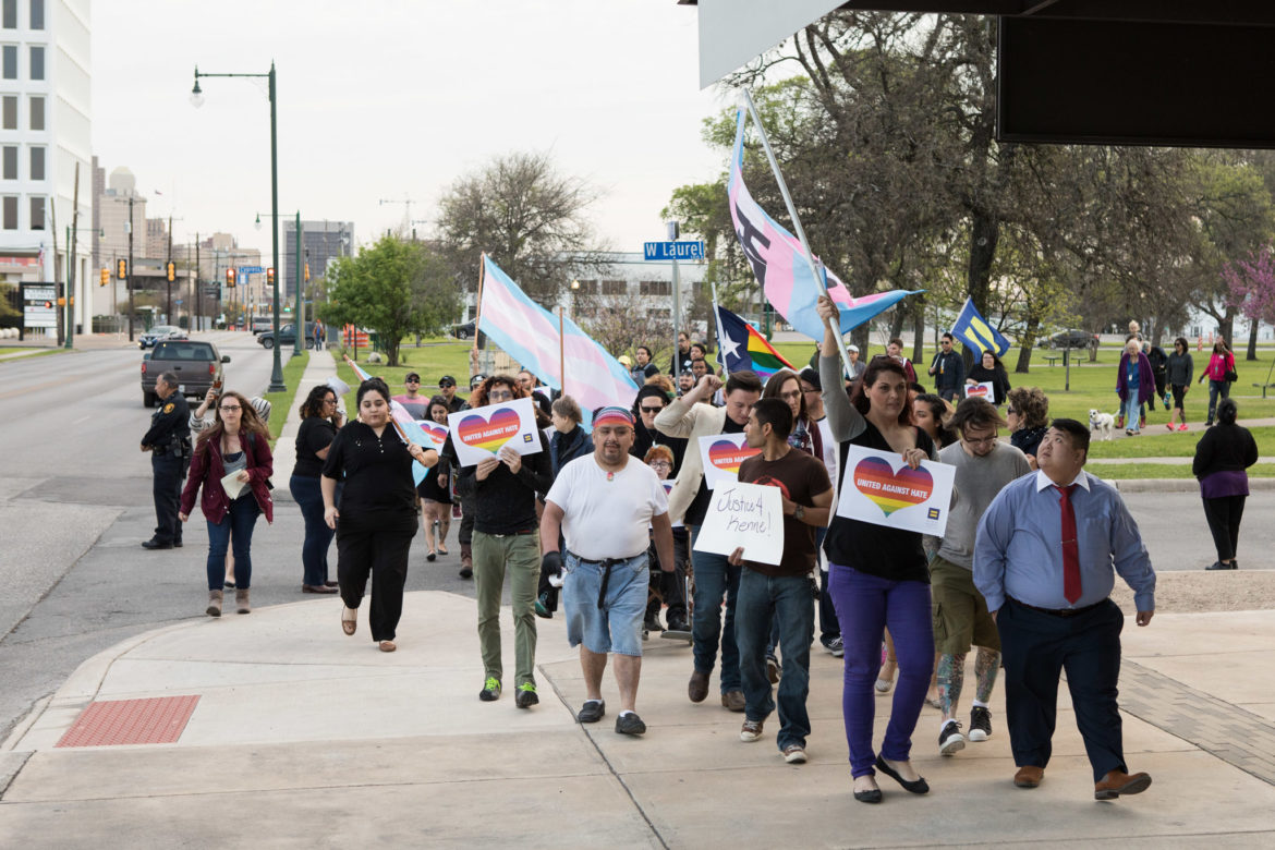 A march is led down Main Street to protest a ruling made in Kenne McFadden's case.