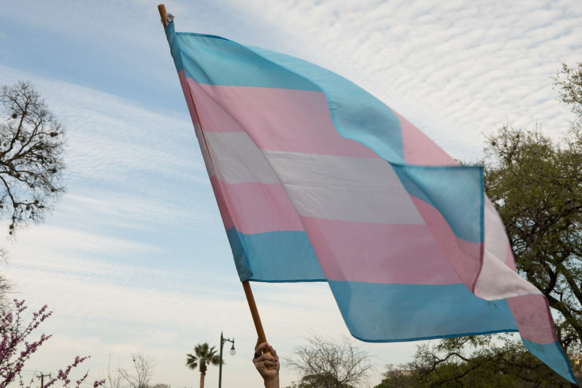 A Transgender Equality flag is held at a rally at Crockett Park to protest a ruling made in the case of Kenne McFadden.