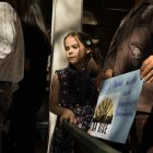 Elisa Denis, 8, holds a sign at the announcement of the collaboration between SA RISE, SAISD Police Chief Curiel, and the SAISD district in regards to the handbook about Senate Bill 4.
