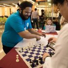 Complete Chess CEO Jesse Lozano plays chess to demonstrate his product at the Louis H. Stumberg Venture Competition.