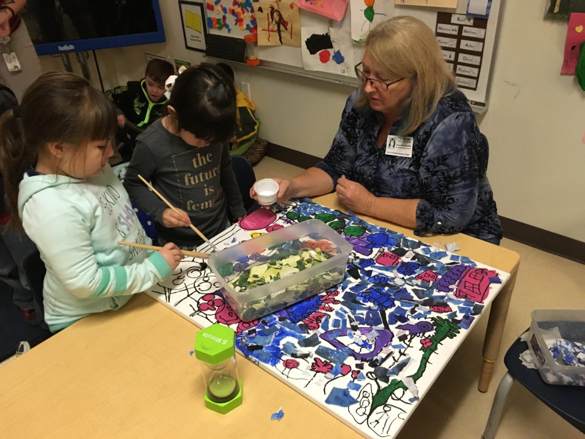 Volunteer resident artist Susan Mayfield works with Pre-K 4 SA West Education Center students for the Gracias San Antonio: Children Are Citizens Project to benefit The Children's Shelter.