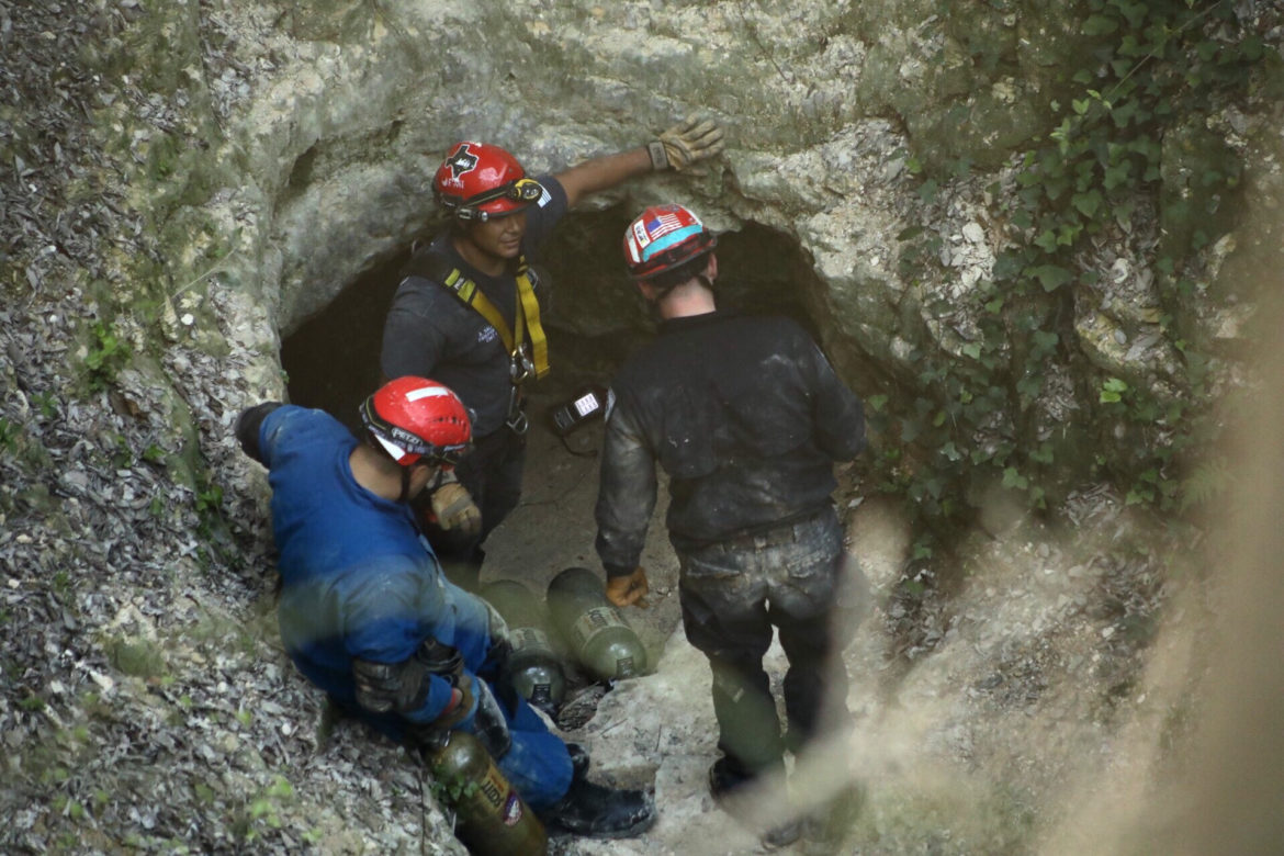 San Antonio firefighters work to extract a student who was trapped in Robber Baron Cave.