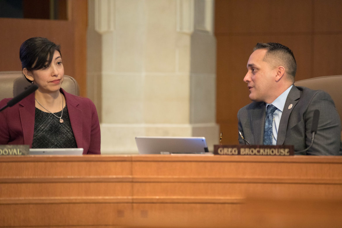 Council members Ana Sandoval (D7) and Greg Brockhouse (D6) speak privately after he cast the lone vote against the appointment of Amy Hardberger and two others as SAWS trustee.