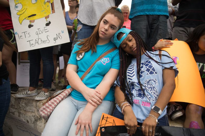 Students Kirsten Leal and D'Asia McCloud lean on each other during the 'die in'.