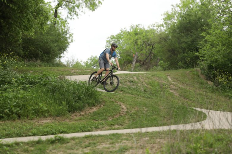 Tight switchbacks are found multiple times along the paved greenway trail.