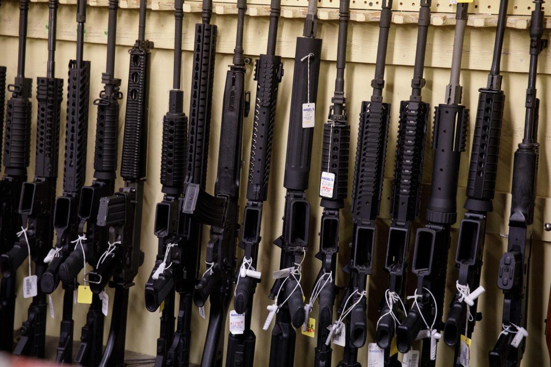 Tactical assault rifles line the wall at Nagel's Gun Shop.