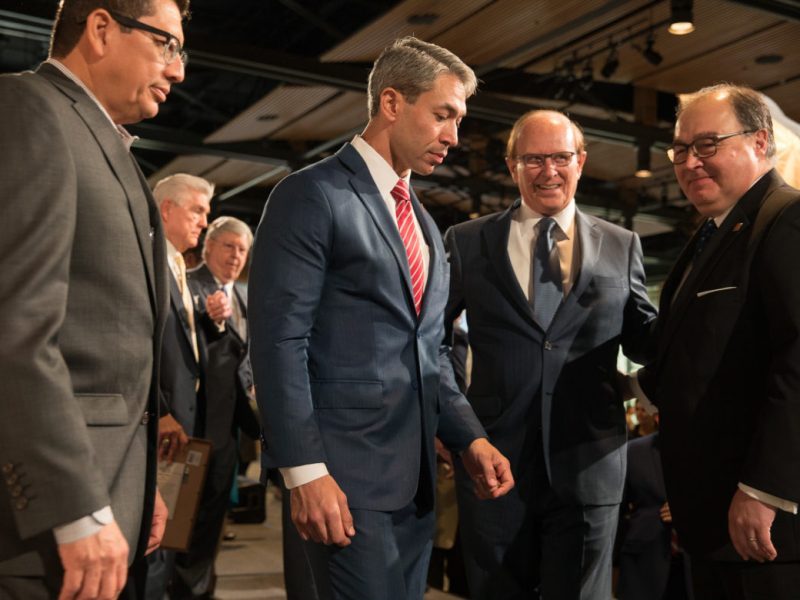 Mayor Ron Nirenberg (center) walks off the stage with County Judge Nelson Wolff (center), San Antonio Chamber of Commerce President Richard Perez (left), and San Antonio Hispanic Chamber of Commerce President Ramiro Cavazos.