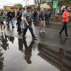 Crowds avoid large puddles during NIOSA.