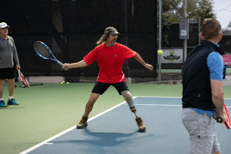 Mike Marsh prepares to hit the tennis ball.