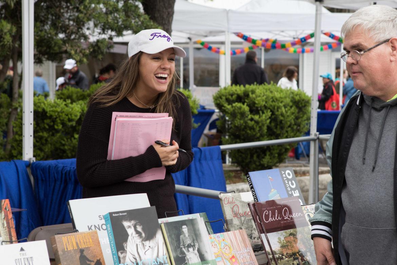 Rebecca Allen, TCU Press marketing coordinator, sells books at the 6th annual San Antonio Book Festival.