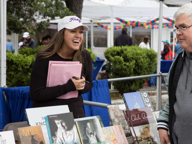 Rebecca Allen, TCU Press marketing coordinator, sells books at the 6th annual San Antonio Book Festival.