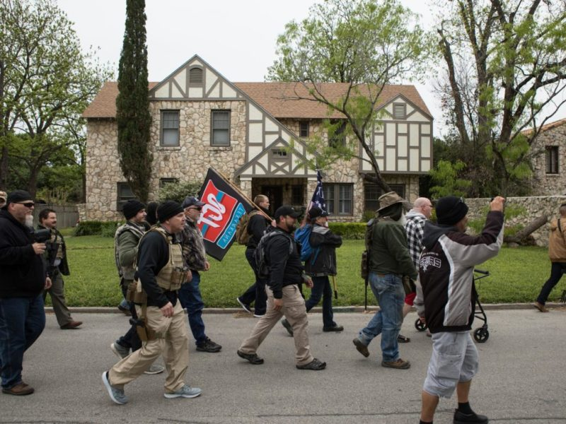 Hundreds of armed second amendment activists march through Olmos Park and to the front door of its City Hall on Saturday to demand the resignation of Police Chief Rene Valenciano.