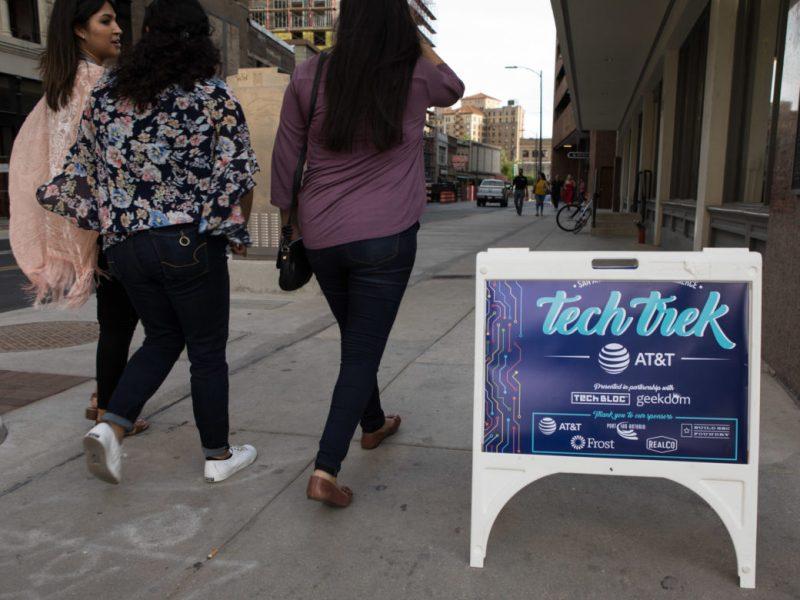 A group of women walks to a Tech Trek event at Geekdom Event Centre.