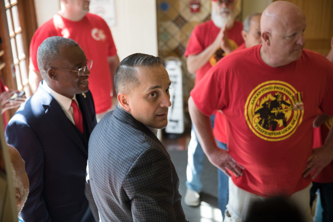 Councilman Greg Brockhouse (D6) speaks with members of the San Antonio Professional Firefighters Association when the petitions to the city charter were delivered in April.