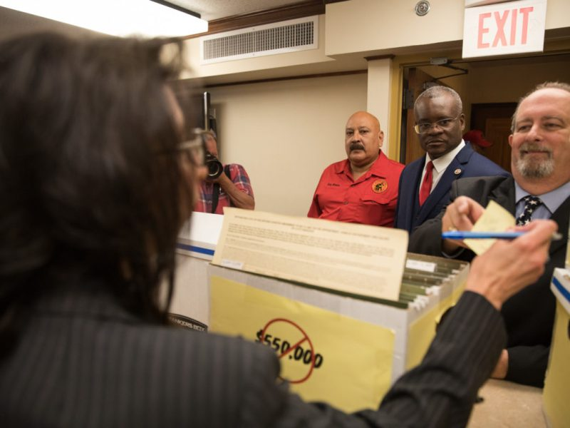 Members of the San Antonio Professional Firefighters Association deliver signed petitions to the City Clerks office.