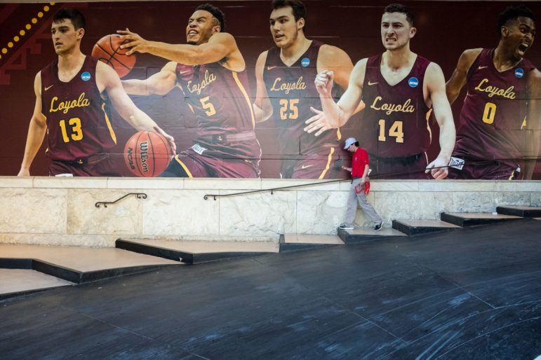 Players of Chicago Loyola University are featured on the wall of the Westin Hotel in downtown San Antonio.