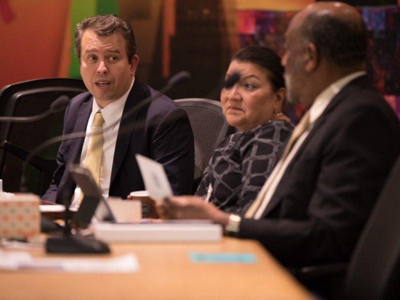 SAISD Superintendent Pedro Martinez (left) speaks with school board trustees.
