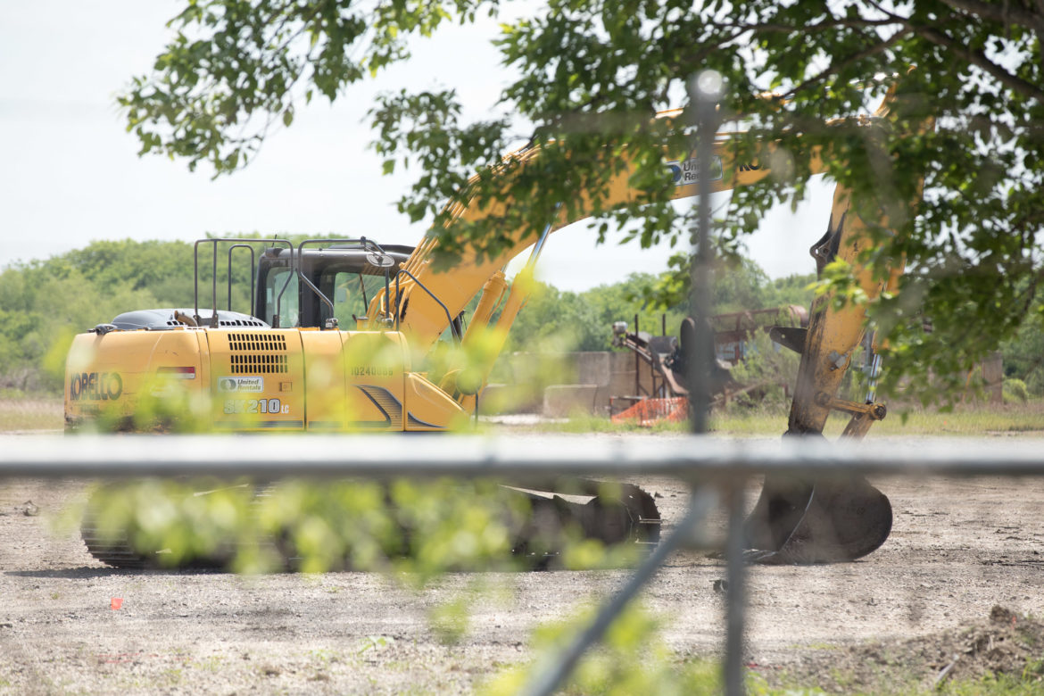 Heavy machinery sits on the property at 11150 Applewhite Rd where 19,000 tons of tire material was removed.