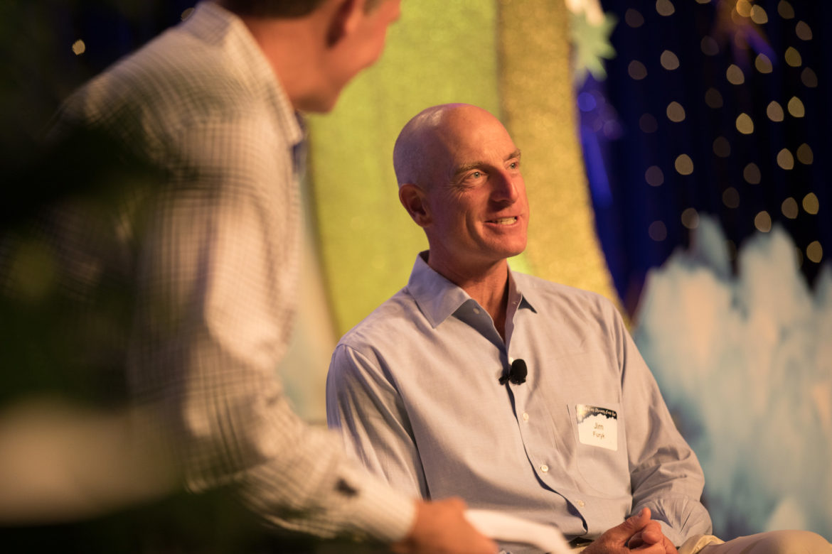Pro golfer Jim Furyk talks with moderator Tom Relf during the NuHope Golf Classic welcome dinner.
