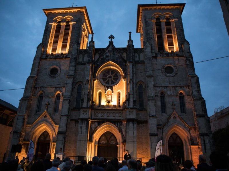 A crowd gathers in front of San Fernando Cathedral for the candlelight vigil.